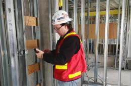 General Contractor Using Construction Measurement Device
