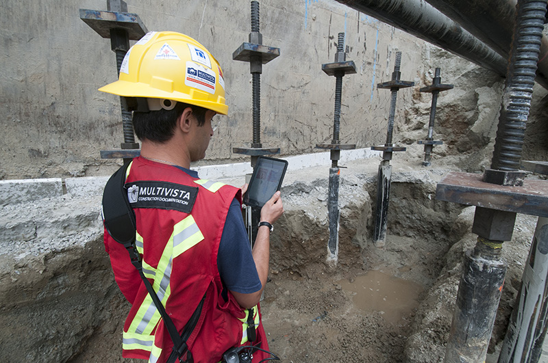 Multivista Worker Performing Photo Documentation on Construction Site