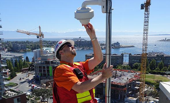 Multivista employee installing 24/7 live construction webcam