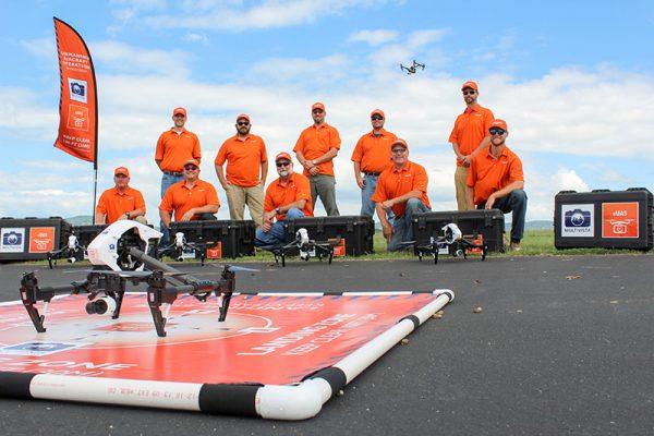 Multivista drone & UAV pilots posing with construction drones & UAVs