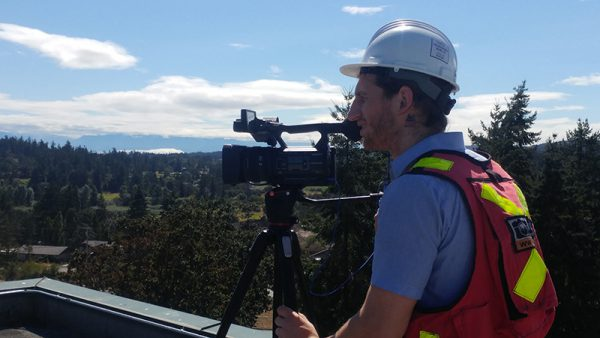 Multivista videographer performing video documentation on job site