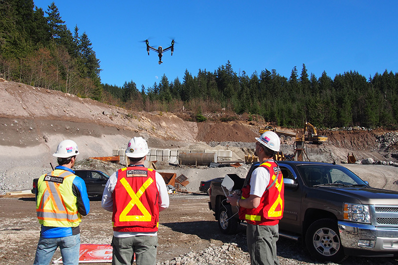 Multivista drone & UAV pilots performing an aerial documentation project on a construction site