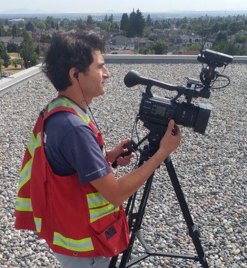 Multivista videographer preparing to record a training video