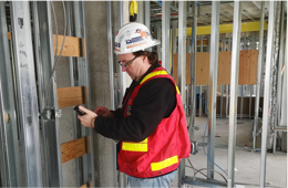 General Contractor Using Construction Measurement Device